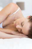 Closeup of pretty woman sleeping in bed Stock Images