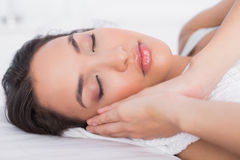 Closeup of a pretty woman sleeping with eyes closed in a bed Royalty Free Stock Images