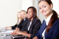 Closeup of a pretty young businesswoman smiling Stock Photo