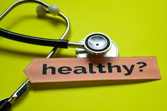 Closeup prevetion cure with stethoscope concept inspiration on yellow backgroundCloseup Healthy with stethoscope concept inspirati. Closeup Healthy with stock photo