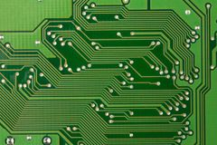 Closeup printed circuit board green for background, there are a lot of conductive tracks.  Stock Photo