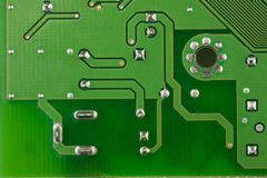 Closeup printed circuit board green there are a lot of conductive tracks. Closeup printed circuit board green for background, there are a lot of conductive Royalty Free Stock Photo