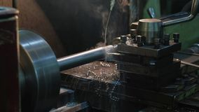 Rotary lathe machine. Closeup process of metal machining, metal disk at the factory, technology turning metal stock footage