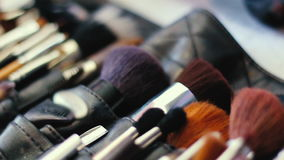 Closeup of professional cosmetics makeup brushes kit in motion stock video footage