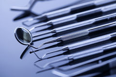 Closeup of professional dental tools on shiny table Royalty Free Stock Photo
