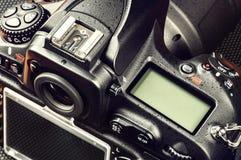 Closeup of professional digital camera Royalty Free Stock Images