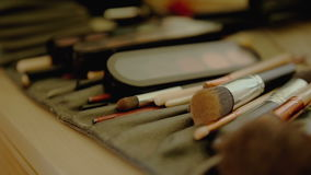 Closeup of professional makeup brushes kit. Closeup of professional cosmetics makeup brushes kit in motion stock video footage