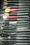 Closeup of professional makeup tools in their holder. Brushes to create makeup royalty free stock photography