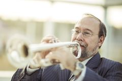 Professional musician performs a musical composition on the pipe Royalty Free Stock Photography