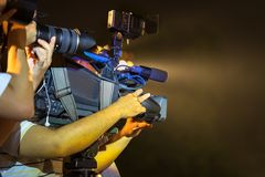 Closeup of professional television camera in event at night.  Royalty Free Stock Photography