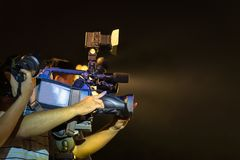 Closeup of professional television camera in event at night.  Royalty Free Stock Photos