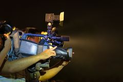 Closeup of professional television camera in event at night.  Stock Images