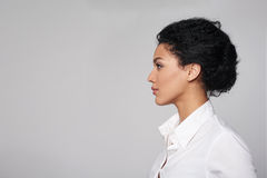 Closeup profile of business woman looking forward. Closeup profile of confident business woman looking forward  on gray background Stock Photos