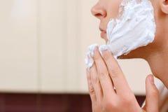 Closeup of profile man applying shaving gel Royalty Free Stock Photo