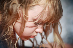 Closeup profile portrait of calm little blond girl Royalty Free Stock Photos