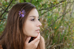 Closeup profile of young female Royalty Free Stock Photos