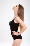 Closeup profile of young skinny model posing looking up Stock Photo