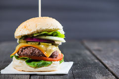 Closeup pub style burger on table Royalty Free Stock Photo