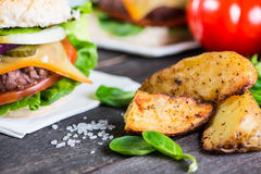 Closeup pub style burger on table Royalty Free Stock Photography