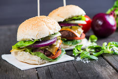 Closeup pub style burger on table Royalty Free Stock Image