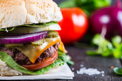 Closeup pub style burger on table Royalty Free Stock Photos