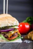Closeup pub style burger on wooden table Stock Photos