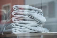 Pullover pile in fashion store showroom. Closeup of pullover pile in fashion store showroom Royalty Free Stock Images