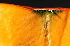 Closeup. Pulp of orange pumpkin. Black background Stock Images