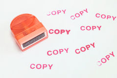 Closeup the pump rubber stamp in copy word with red ink copy word on white paper textured background Royalty Free Stock Photography