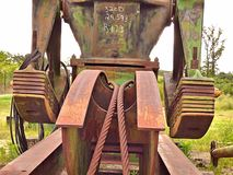 Closeup of a pumpjack for an oil well sitting idle in a field on Route 66. Closeup view of a dismantled pumpjack for an oil well sitting idle in a field on royalty free stock image