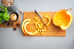 Closeup on pumpkin on cutting board Royalty Free Stock Photo