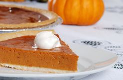 Closeup pumpkin pie slice and whip cream Stock Photo