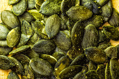 Closeup of Pumpkin Seeds on a Wooden Cutting Board. Studio shot Royalty Free Stock Photography