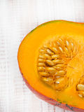 Closeup of a pumpkin. On wooden background Royalty Free Stock Photos