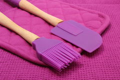 Closeup of purple silicone kitchen accessories Royalty Free Stock Image
