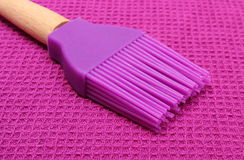 Closeup of purple silicone kitchen accessories Royalty Free Stock Photography