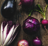 Closeup of purple vegetable group collection on wooden table Stock Images