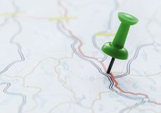 Closeup of pushpin showing the location on the map Royalty Free Stock Images