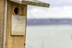 Closeup of quality basic handmade birdhouse with hole for small Royalty Free Stock Photos