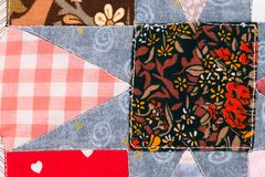 Closeup of quilt pattern. Closeup of beautiful handmade sewed quilt pattern Royalty Free Stock Photo