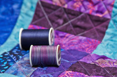 Quilt and quilting thread. Closeup of quilt with quilting thread Stock Images