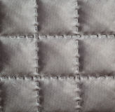 Closeup of quilted fabric Stock Photo