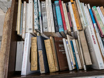 Closeup of a rack of books on display at academic book shop in P. Paris, France, Sept 8, 2015: Closeup of rows of used and antique books displayed in sidewalk Stock Images