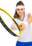 Closeup on racket in hand of tennis player Stock Image