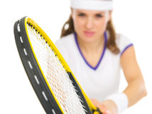 Closeup on racket in hand of tennis player Royalty Free Stock Photos
