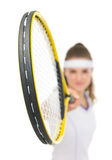 Closeup on racket holding by tennis player Royalty Free Stock Photography