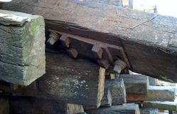 Closeup of rail joiner on old railway sleepers. Closeup of a pile old railway sleepers with metal rail joiner and bolts Royalty Free Stock Image