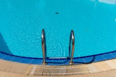 Closeup Railing pool and blue water pool royalty free stock image
