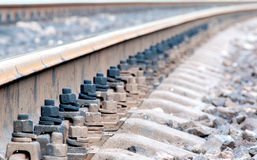 Closeup of rails and sleepers leaving afar Royalty Free Stock Photography