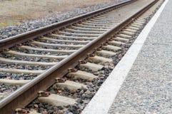 Closeup of railway track and rail platform Royalty Free Stock Photography
